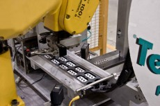 A automated robot packaging Cadence's products.
